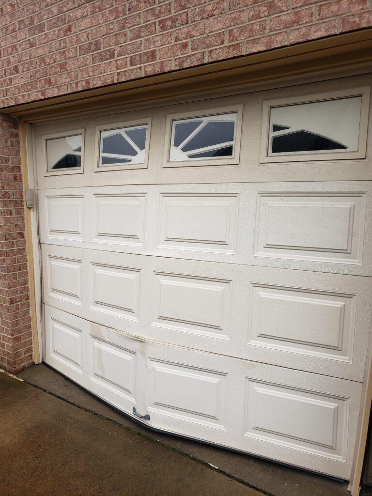 bent garage door outside view